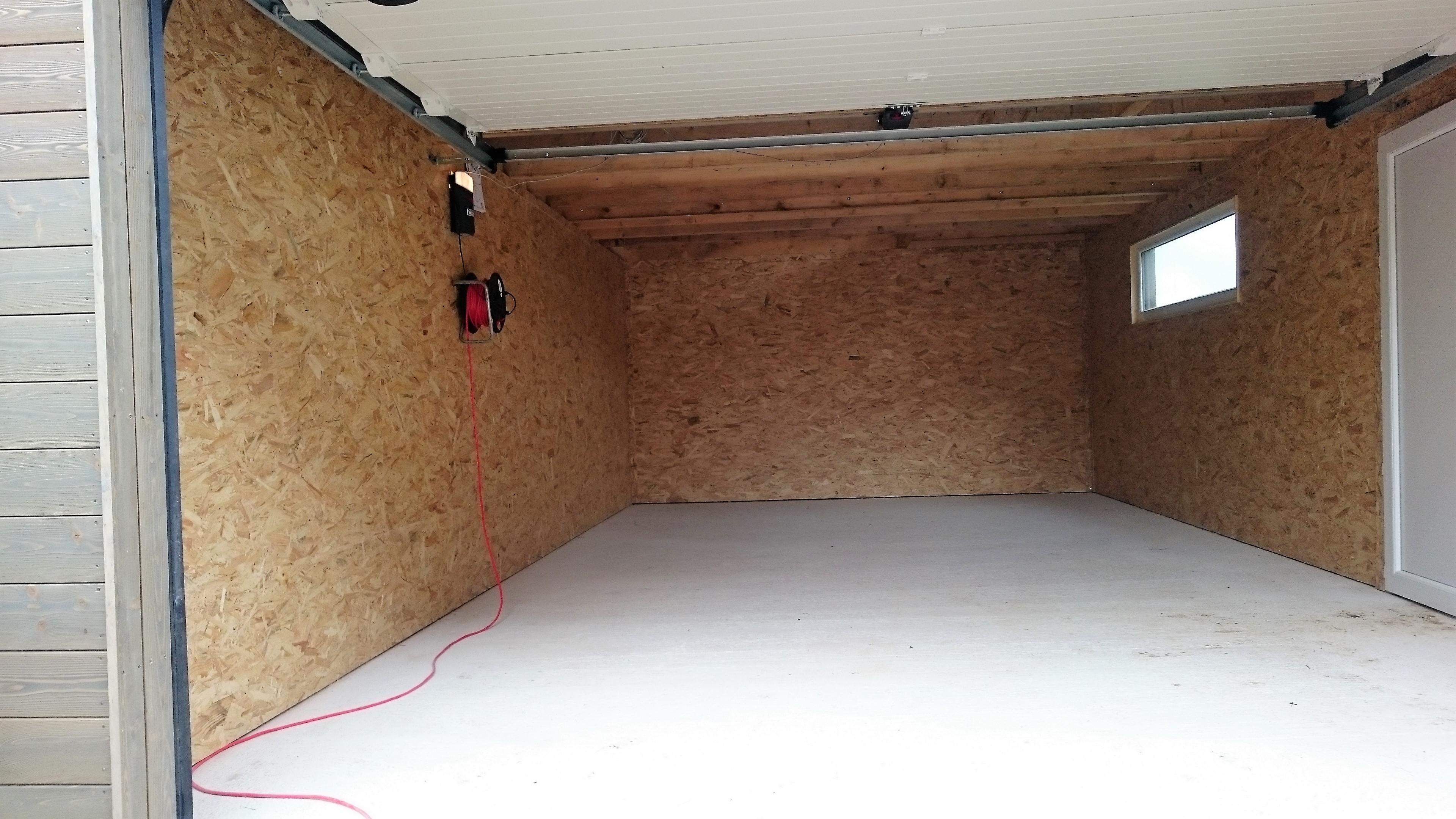Garage bois garage ossature bois garage en kit et sur for Doublage mur interieur